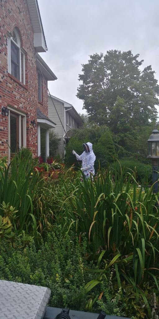 pest control crew spraying a home in Pennsylvania